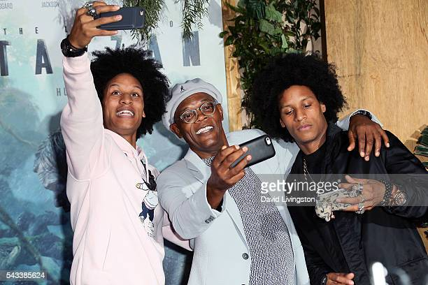 Dancers Les Twins pose for a selfie with actor Samuel L Jackson at the premiere of Warner Bros Pictures' 'The Legend of Tarzan' at the Dolby Theatre...