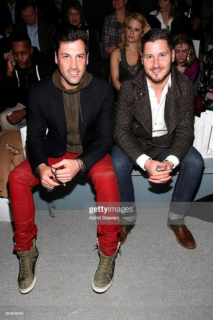 Dancers Maksim Chmerkovkskiy and <a gi-track='captionPersonalityLinkClicked' href=/galleries/search?phrase=Valentin+Chmerkovskiy&family=editorial&specificpeople=8128683 ng-click='$event.stopPropagation()'>Valentin Chmerkovskiy</a> attend the Zang Toi Fall 2013 fashion show during Mercedes-Benz Fashion Week at The Stage at Lincoln Center on February 13, 2013 in New York City.