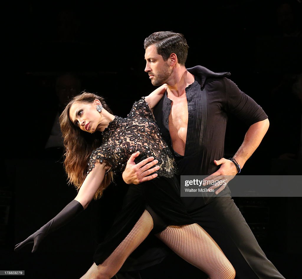 Dancers <a gi-track='captionPersonalityLinkClicked' href=/galleries/search?phrase=Maksim+Chmerkovskiy&family=editorial&specificpeople=4251170 ng-click='$event.stopPropagation()'>Maksim Chmerkovskiy</a> and <a gi-track='captionPersonalityLinkClicked' href=/galleries/search?phrase=Karina+Smirnoff&family=editorial&specificpeople=4029232 ng-click='$event.stopPropagation()'>Karina Smirnoff</a> performs 'Forever Tango' Press Preview at Walter Kerr Theatre on July 11, 2013 in New York City.