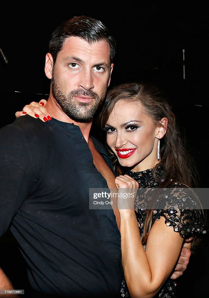 Dancers <a gi-track='captionPersonalityLinkClicked' href=/galleries/search?phrase=Maksim+Chmerkovskiy&family=editorial&specificpeople=4251170 ng-click='$event.stopPropagation()'>Maksim Chmerkovskiy</a> and <a gi-track='captionPersonalityLinkClicked' href=/galleries/search?phrase=Karina+Smirnoff&family=editorial&specificpeople=4029232 ng-click='$event.stopPropagation()'>Karina Smirnoff</a> pose backstage following their performance of 'Forever Tango' at the Walter Kerr Theatre on July 30, 2013 in New York City.