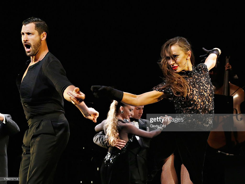 Dancers <a gi-track='captionPersonalityLinkClicked' href=/galleries/search?phrase=Maksim+Chmerkovskiy&family=editorial&specificpeople=4251170 ng-click='$event.stopPropagation()'>Maksim Chmerkovskiy</a> and <a gi-track='captionPersonalityLinkClicked' href=/galleries/search?phrase=Karina+Smirnoff&family=editorial&specificpeople=4029232 ng-click='$event.stopPropagation()'>Karina Smirnoff</a> take part in the 'Forever Tango' Curtain Call at Walter Kerr Theatre on July 30, 2013 in New York City.