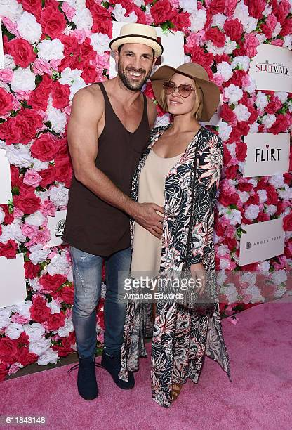Dancers Maksim Chmerkovskiy and Peta Murgatroyd attend the Amber Rose SlutWalk 2016 at Pershing Square on October 1 2016 in Los Angeles California
