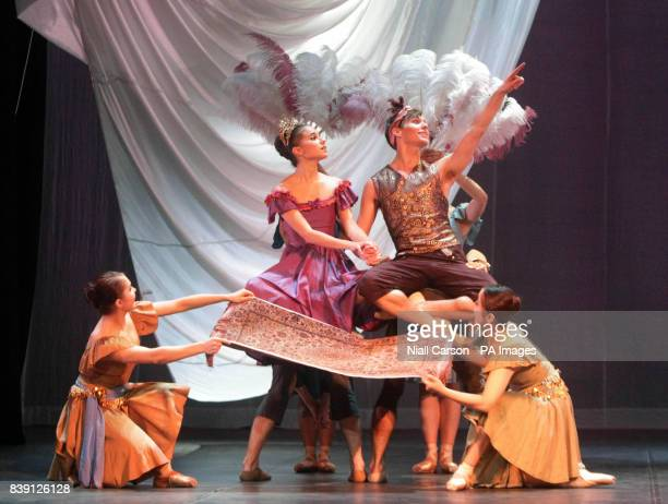 Dancers Maria Ledesma and Noah Hellwig sit on a flying carpet during a dress rehearsal for Ballet Ireland's Scheherazade and 1001 Arabian nights...