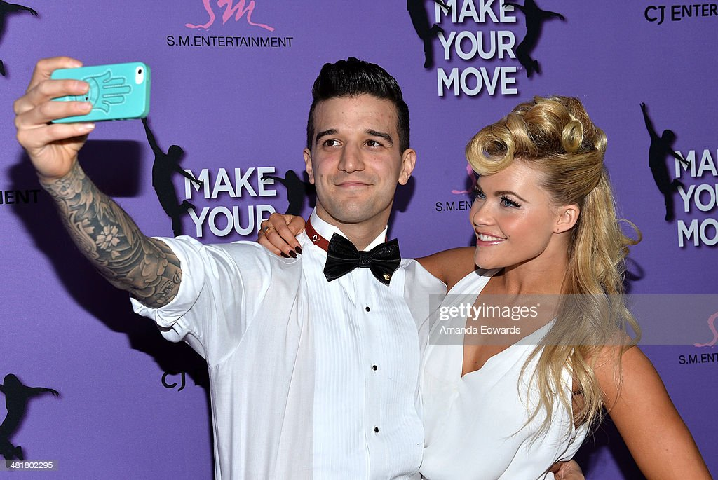 Dancers <a gi-track='captionPersonalityLinkClicked' href=/galleries/search?phrase=Mark+Ballas&family=editorial&specificpeople=4531129 ng-click='$event.stopPropagation()'>Mark Ballas</a> (L) and <a gi-track='captionPersonalityLinkClicked' href=/galleries/search?phrase=Witney+Carson&family=editorial&specificpeople=10833254 ng-click='$event.stopPropagation()'>Witney Carson</a> take a selfie at the Los Angeles premiere of 'Make Your Move' at Pacific Theaters at the Grove on March 31, 2014 in Los Angeles, California.