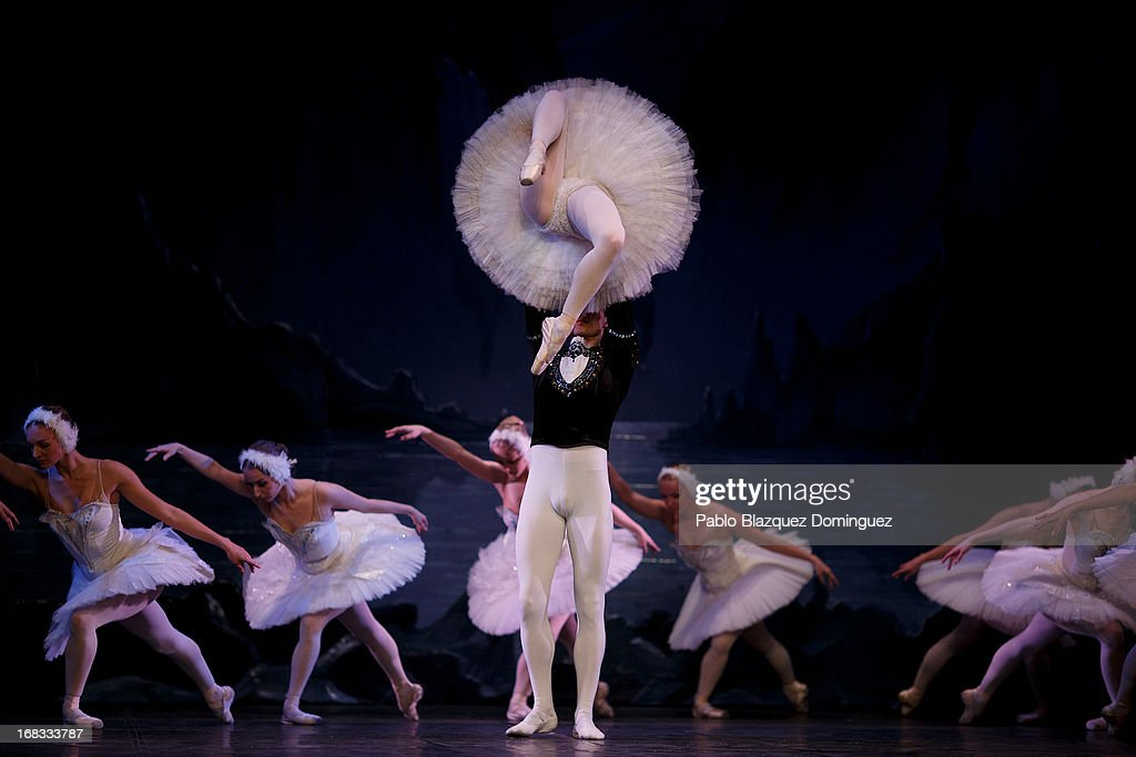 Dancers Nataliya Kungurtseva (front row top) and Alexander Butrimovich (front row bottom) of the Classical Russian Ballet perform during a rehearsal of 'Swan Lake' at Nuevo Apolo Theatre on May 8, 2013 in Madrid, Spain.