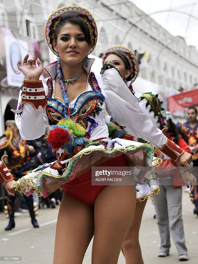 Dancers of a Diablada brotherhood perform during the Carnival of Oruro, in the mining town of Oruro, 240 km south of La Paz on February 9, 2013. The Carnival of Oruro was inscribed by UNESCO on the Representative List of the Intangible Cultural Heritage of Humanity in 2008. AFP PHOTO/AIZAR RALDES