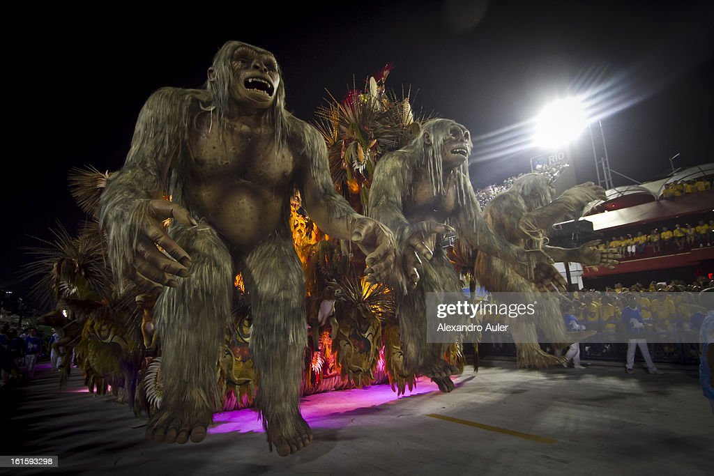 Dancers of Beija Flor School perform during the 2013 Brazilian Carnival at Sapucaí Smbodrome on February 12, 2013 in Rio de Janeiro, Brazil. Rio's two nights of Carnival parades began on February 10 in a burst of fireworks and to the cheers of thousands of turists and locals who have previously enjoyed Street celebrations (known as Blocos de rua) all around the city.
