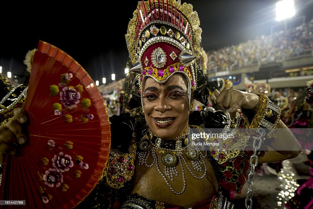 Dancers of Mocidade Independente de Padre Miguel Samba School perform during the fifth parade of the day at 2013 Brazilian Carnival at Sapucaí Smbodrome on February 11; 2013 in Rio de Janeiro; Brazil. Rio's two nights of Carnival parades began on February 10 in a burst of fireworks and to the cheers of thousands of turists and locals who have previously enjoyed Street celebrations (known as Blocos de rua) all around the city.