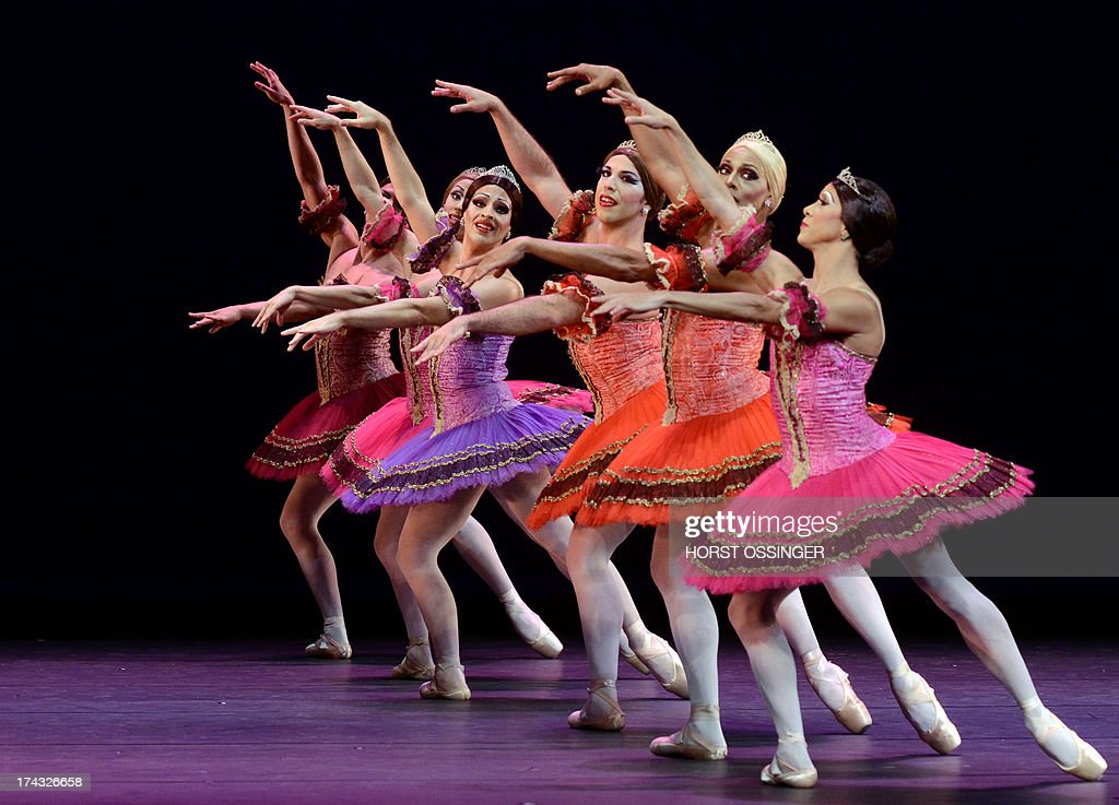 Dancers of the ballet company 'Les Ballets Trockadero de Monte Carlo' dance during a press call in occasion of the German premiere at the Rhine Opera in Duesseldorf, western Germany, on July 23, 2013. The German Opera on the Rhine is hosting the drag ballet group from 23 until 28 July 2013. AFP PHOTO / DPA / HORST OSSINGER GERMANY OUT