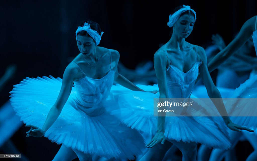 Dancers of the Bolshoi Ballet perform during a photocall for 'Swan Lake' at The Royal Opera House on July 29, 2013 in London, England.