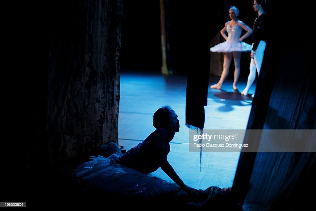 Dancers of the Classical Russian Ballet strech at backstage before a rehearsal of 'Swan Lake' at Nuevo Apolo Theatre on May 8, 2013 in Madrid, Spain.