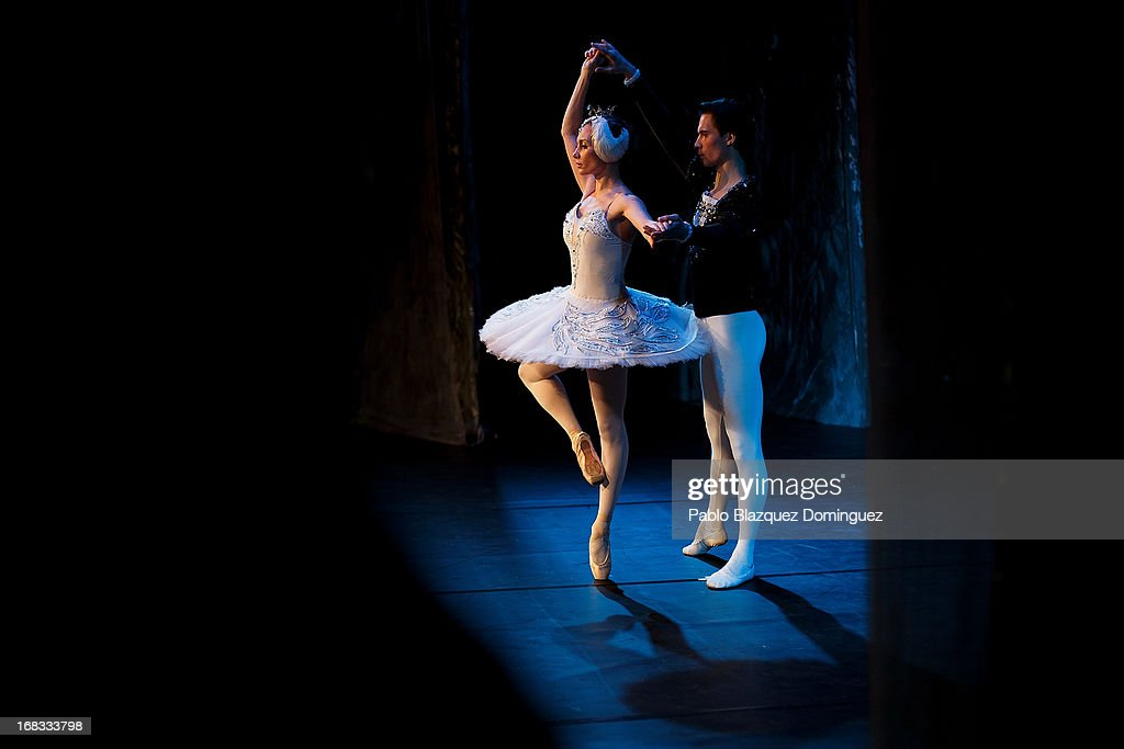 Dancers of the Classical Russian Ballet warm up on stage before a rehearsal of 'Swan Lake' at Nuevo Apolo Theatre on May 8, 2013 in Madrid, Spain.