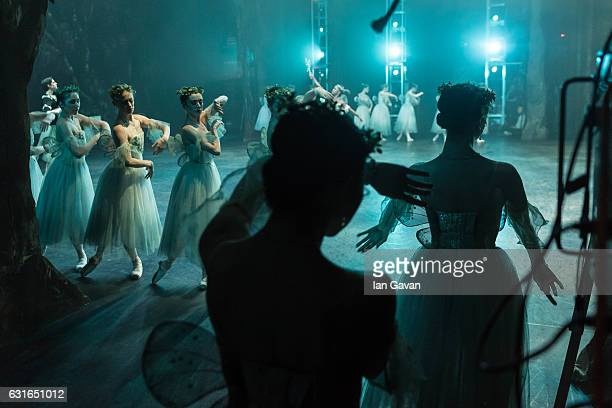 Dancers of the English National Ballet wait in the wings during performing 'Giselle' at the Coliseum on January 13 2017 in London England