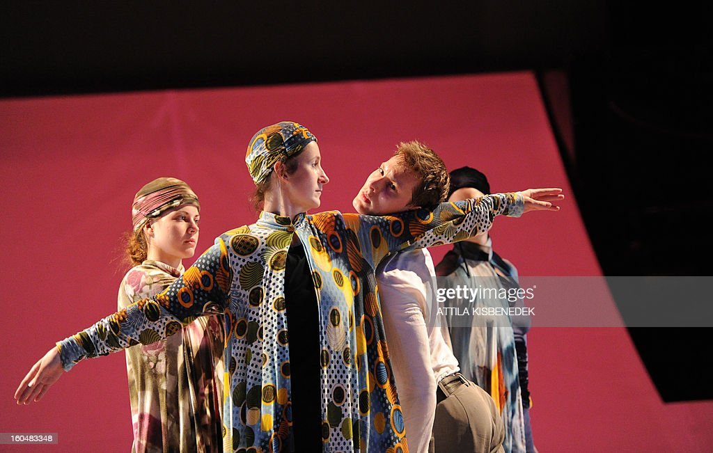 Dancers of the GG Dance Eger contemporary group perform during the rehearsal for the premiere 'Les Préludes' (The Wooden Prince), choreographed by Hungarian Mate Meszaros and Tamas Topolanszky at the National Dance Theater in Budapest on February 1, 2013. The performance premiers on February 1, 2013.