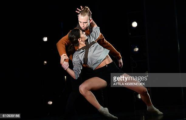 Dancers of the Hungarian contemporary group the Budapest Dance Theater perform on the stage of MOM cultural center in Budapest on September 28 2014...