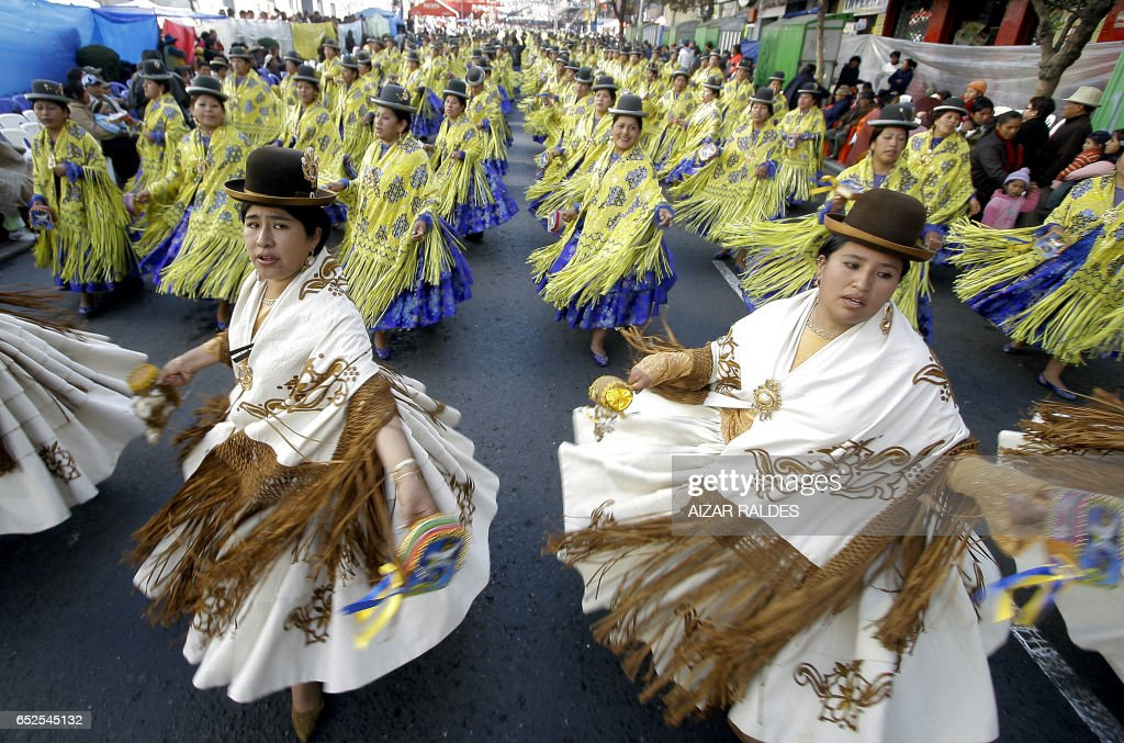 Dancers of the Morenada participate in the entrance of Jesus del Gran Poder (Jesus of Great Power) during the festival of the same name in La Paz on June 6, 2009. The pagan festival, where 55 fraternities and some 35,000 folklorists participate, takes to the street of the Bolivian capital in reverence of Sr. Jesus del Gran Poder. AFP PHOTO/Aizar RALDES /