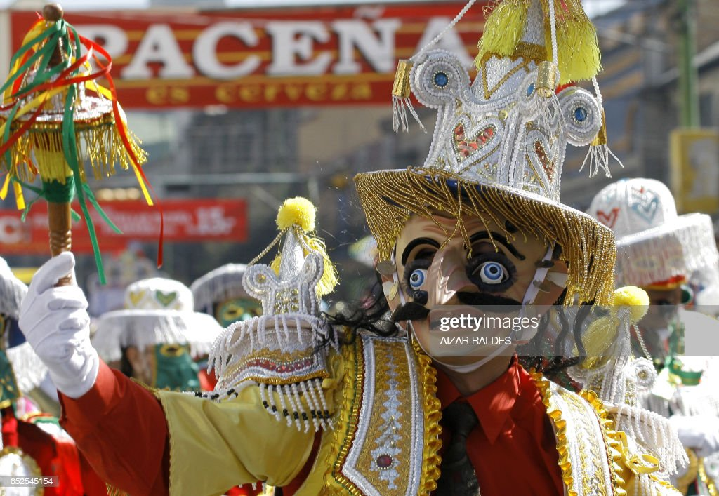 Dancers of the Morenada participate in the entrance of Jesus del Gran Poder (Jesus of Great Power) during the festival of the same name in La Paz on June 6, 2009. The pagan festival, where 55 fraternities and some 35,000 folklorists participate, takes to the street of the Bolivian capital in reverence of Sr. Jesus del Gran Poder. AFP PHOTO/Aizar RALDES ---------MORE