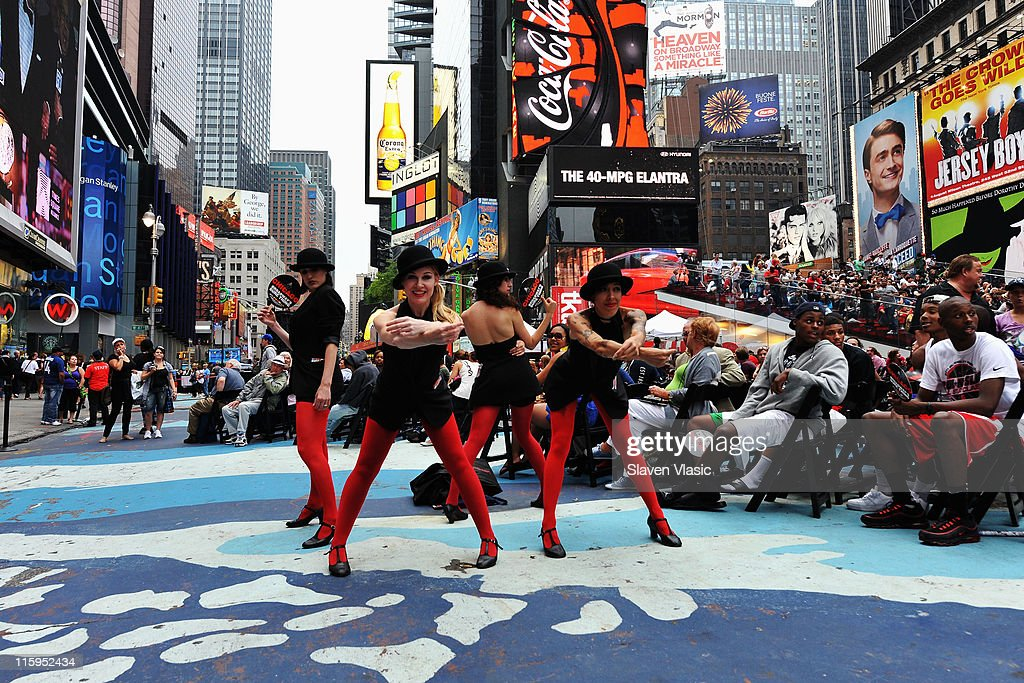 Dancers of the musical Chicago perform during the simulcast of the 65th Annual Tony Awards in Times Square on June 12, 2011 in New York City.