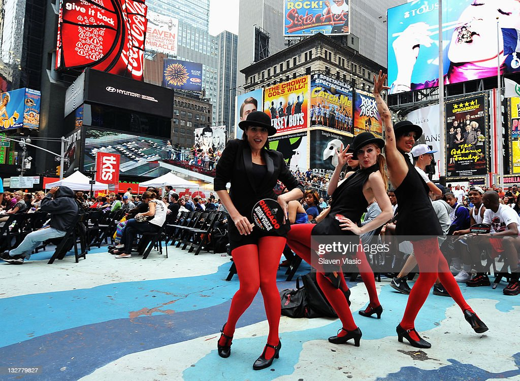 Dancers of the musical Chicago perform during the Times Square simulcast of the 65th Annual Tony Awards in Times Square on June 12, 2011 in New York City.