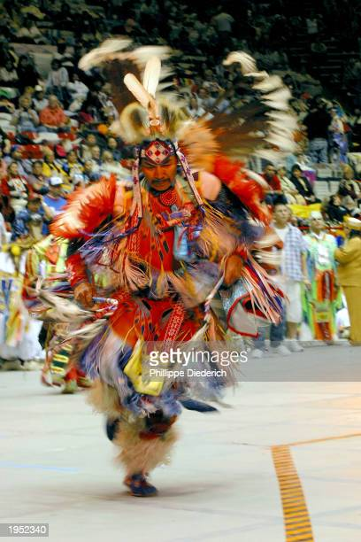 Dancers over age 70 participate in an intertribal dance at the 20th annual Gathering Of Nations PowWow April 25 2003 in Albuquerque New Mexico The...