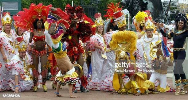 Dancers parade down the the Mall as part of the Golden Jubilee celebrations of Britain's Queen Elizabeth II Earlier the Queen had travelled to St...