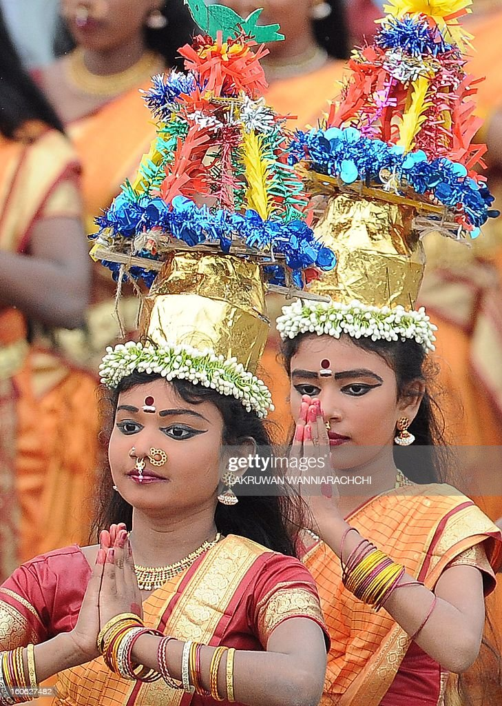 Dancers participate in a parade marking the country's 65th Independence Day in the northeastern town of Trincomalee on February 4, 2013. Sri Lanka marked its freedom anniversary with a thinly veiled denunciation of Western moves to pass a new resolution against the island at the UN Human Rights Council.