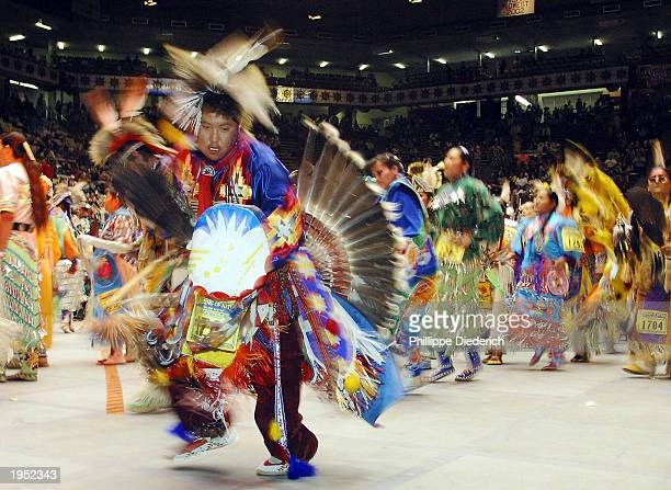 Dancers participate in an intertribal dance at the 20th annual Gathering Of Nations PowWow April 25 2003 in Albuquerque New Mexico The threeday event...