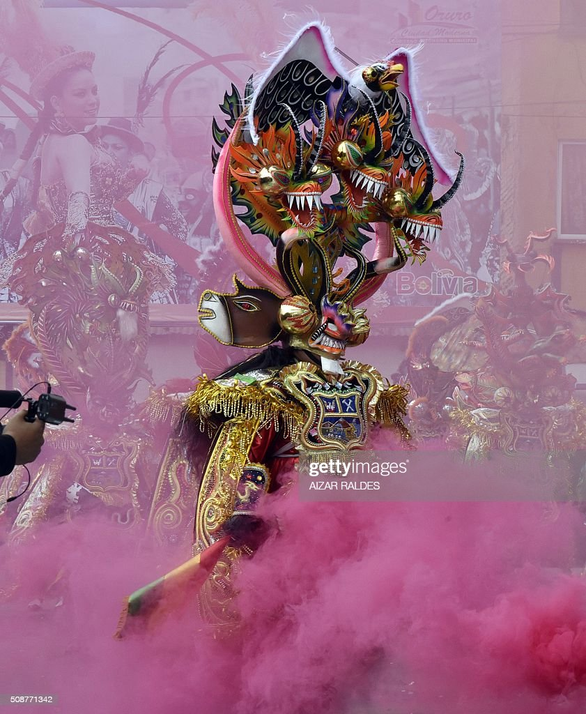 Dancers participate in the 'diablada' or devil's dance on February 6, 2016 during carnival in Oruro, Bolivia, 240 km south of La Paz. The Carnival of Oruro is a UNESCO Masterpiece of the Oral and Intangible Heritage of Humanity. AFP PHOTO/AIZAR RALDES / AFP / AIZAR RALDES