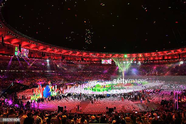 Dancers perform as confetti falls near the conclusion of the Closing Ceremony on Day 16 of the Rio 2016 Olympic Games at Maracana Stadium on August...