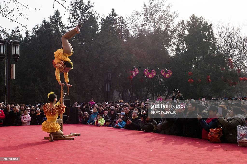 Dancers perform at the Altar of the Earth in Ditan park in Beijing on February 12, 2016. The ceremony is a re-enactment of sacrifices once made by China's emperors to the God of the Earth to guarantee good harvests in the new year. Millions of Chinese are celebrating the 'Spring Festival', the most important holiday on the Chinese calendar, which this year marks the beginning of the Year of the Monkey. AFP PHOTO / FRED DUFOUR / AFP / FRED DUFOUR