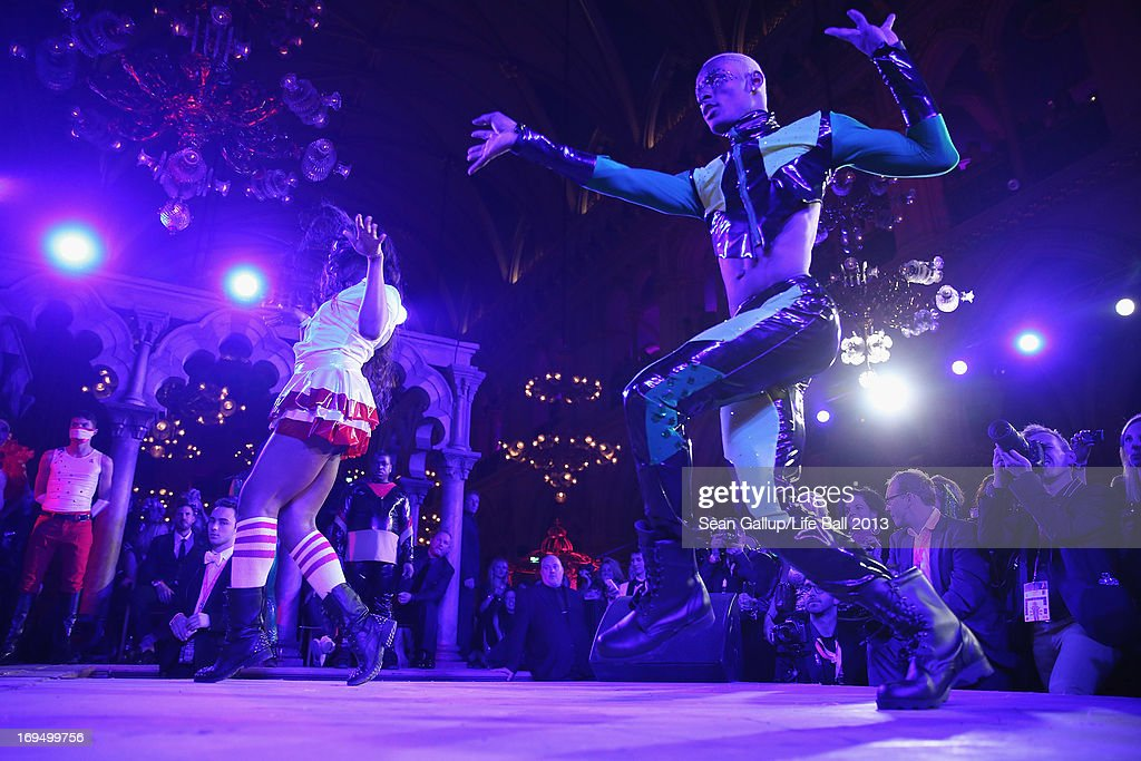 Dancers perform at the Fergie show, of the Black Eyed Peas, at the after show party at the 2013 Life Ball at city hall on May 25, 2013 in Vienna, Austria.