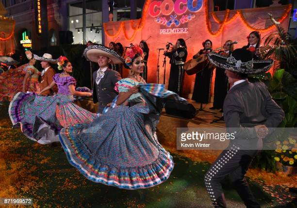 Dancers perform at the premiere of Disney Pixar's 'Coco' at the El Capitan Theatre on November 8 2017 in Los Angeles California