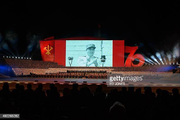 Dancers perform before a giant television screen showing late North Korean leader Kim IlSung in Pyongyang on October 11 2015 North Korea is marking...