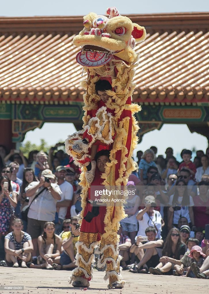 Dancers perform Chinese Dragon dance during the celebrations of the Chinese New Year at Nan Hua Temple in Pretoria on February 7, 2016 ahead of the upcoming Chinese Lunar New Year. The Chinese New Year will start on February 8th and will be the year of the fire monkey.