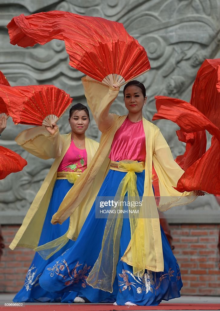 Dancers perform during a ceremony marking the 227th anniversary of the Vietnam's Dong Da-Ngoc Hoi victory over China's Qing dynasty's troops in 1789 at a memorial monument to Vietnamese King Quang Trung (1788-1792), winner of the war, in Hanoi on February 12, 2016. AFP PHOTO / HOANG DINH Nam / AFP / HOANG DINH NAM