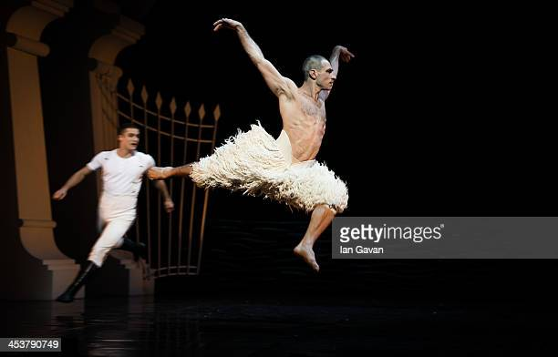 Dancers perform during a photocall for Matthew Bourne's 'Swan Lake' at Sadler's Wells Theatre on December 5 2013 in London England