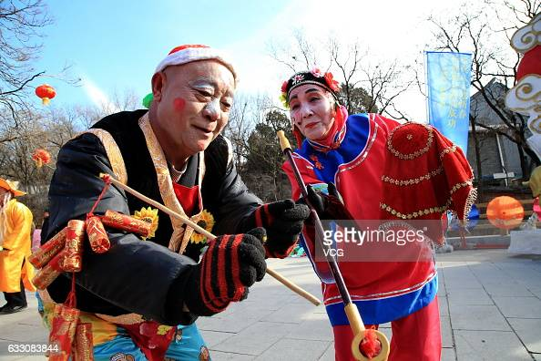 Dancers perform during a temple fair at Badachu Park to celebrate Chinese new year the year of the Rooster on January 29 2017 in Beijing China