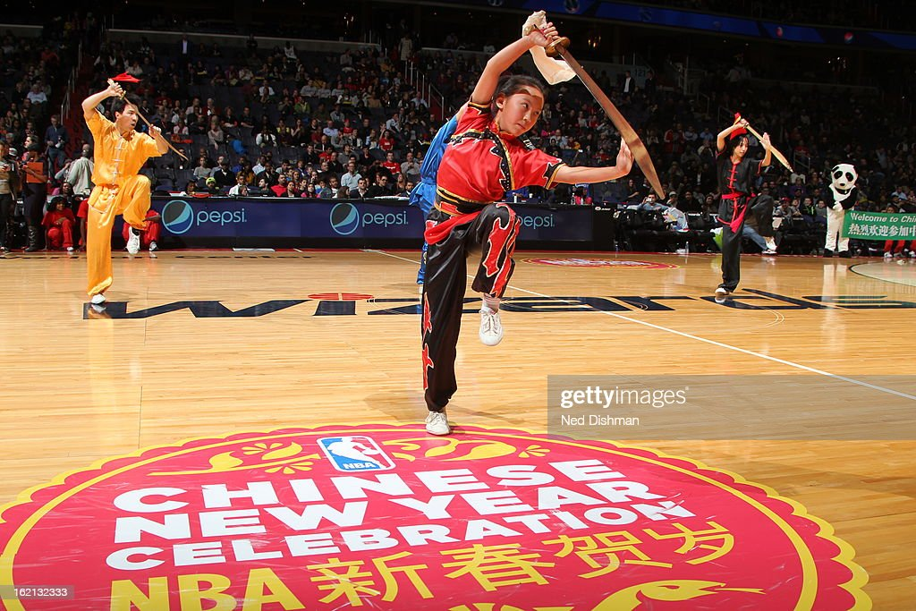 Dancers perform during halftime to celebrate the Chinese New Year during the game between the Washington Wizards and Brooklyn Nets on February 8, 2013 at the Verizon Center in Washington, DC.