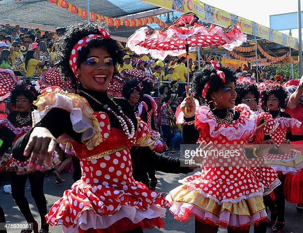 Dancers perform during the carnival parade in Barranquilla Colombia on March 1 2014 Barranquilla's Carnival a tradition cretaed by locals at the end...
