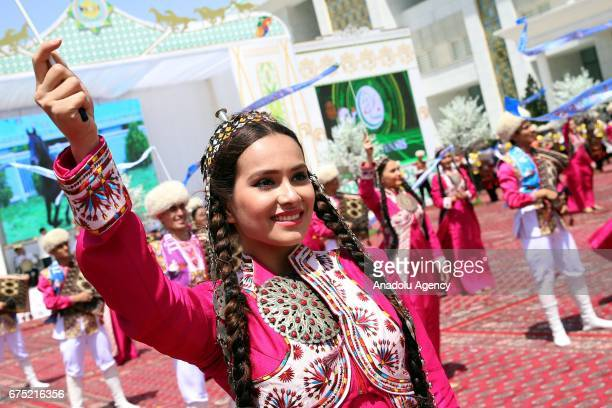 Dancers perform during the ceremony of Annual Turkmen Racing Horse Festival at Equestrian Sports Complex and Hippodrome in Ashgabat Turkmenistan on...