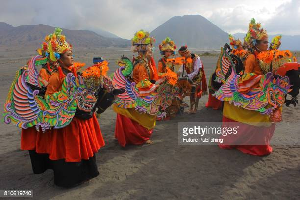 Dancers perform during the cultural ceremony 'Yadnya Kasada' to make an offering to their god at the plateau of Mount Bromo on July 7 2017 in...