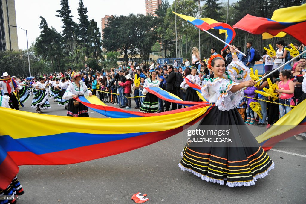 dancers perform during the inaugural parade of the 15th Ibero-American Theatre Festival in Bogota on March 12, 2016. The biennial festival's first edition took place in 1988 and is considered the largest theatre festival in the world.