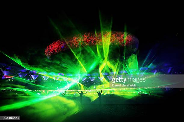 Dancers perform during the laser show during the Closing Ceremony for the Delhi 2010 Commonwealth Games at Jawaharlal Nehru Stadium on October 14...