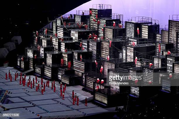 Dancers perform during the Metropolis segment of the Opening Ceremony of the Rio 2016 Olympic Games at Maracana Stadium on August 5 2016 in Rio de...
