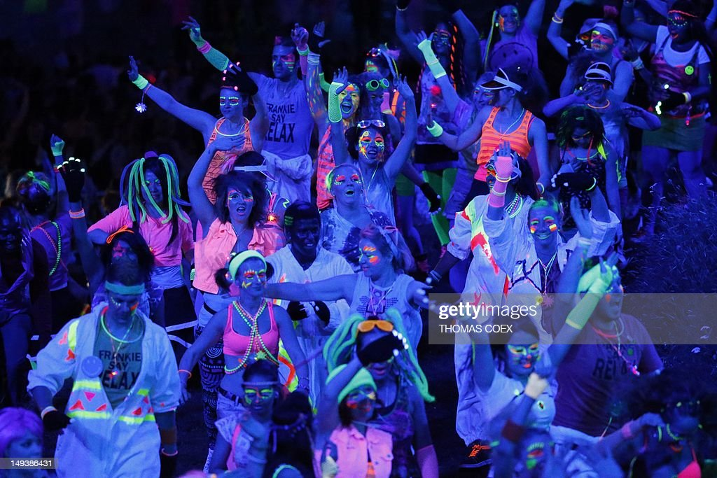Dancers perform during the 'Night Out' scene in the opening ceremony of the London 2012 Olympic Games on July 27, 2012 at the Olympic stadium in London. AFP PHOTO / THOMAS COEX