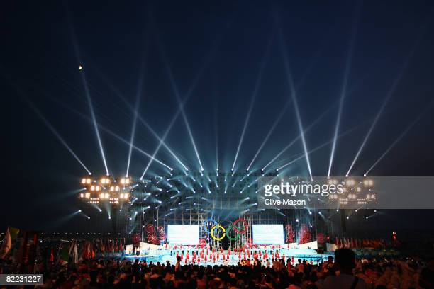 Dancers perform during the opening launch ceremony held at the Qingdao Olympic Sailing Center during day 1 of the Beijing 2008 Olympic Games on...