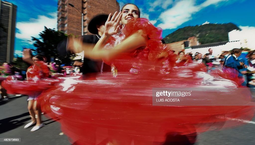 Dancers perform during the opening of the 14th Ibero-American Theater Festival in Bogota on April 5, 2014. The festival, which first edition took place in 1988, is held every two years and is considered the largest theater festival in the world. AFP PHOTO/Luis Acosta /