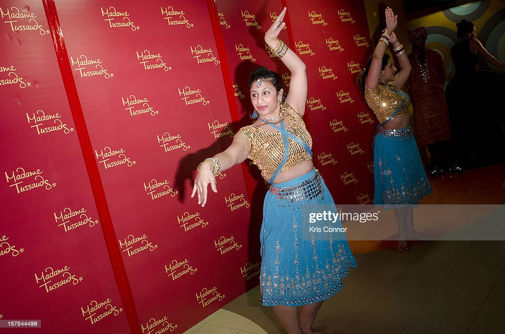 Dancers perform during the unveiling of Shah Rukh Khan, Aishwarya Rai, Amitabh Bachchan, Kareena Kapoor and Hrithik Roshan wax figures are unveiled during the launch of the traveling Bollywood Exhibit at Madame Tussauds on December 4, 2012 in Washington, DC.
