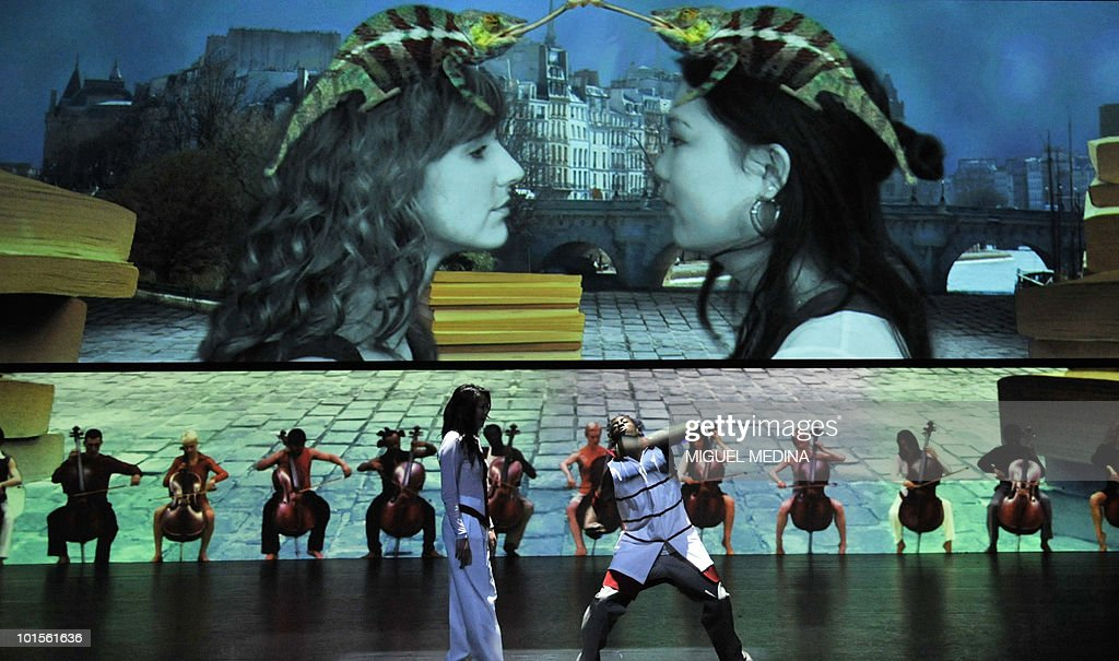 Dancers perform in front of a giant screen during their first performance before an audience of the Orphee opera, choregraphed by French Jose Montalvo and Dominique Hervieu on May 18, 2010 at the theatre de Chaillot in Paris. The opera takes place until June 19, 2010.
