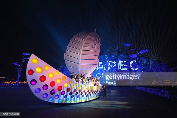 Dancers perform in front of the National Stadium known as 'Bird's Nest' before the fireworks show of the Welcome Banquet for 2014 APEC leaders at the...